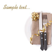 Close up of a knife and fork on a white plate with napkin on the white background — Stock Photo