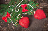 Christmas decorations and fir branches on the old wooden background — Stock Photo