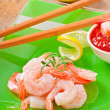 Tails of shrimps with fresh lemon and rosemary in a green plate — Stock Photo