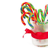 Christmas candy canes on white background — Stock Photo