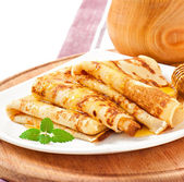 Delicious pancakes with honey — Stock Photo