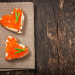 Sandwich with red caviar in the form of a heart — Stock Photo #38323383