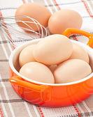 Raw eggs in a saucepan — Stock Photo