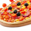 Pizza with vegetables, chicken, ham and olives isolated on white — Stock Photo #39947251