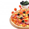 Pizza with vegetables, chicken, ham and olives isolated on white — Stock Photo #39947255