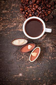 Cup espresso coffee on rustic wooden background — Stock Photo