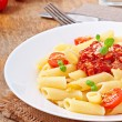 Penne pasta with bolognese sauce, parmesan cheese and basil — Stock Photo #40426257