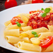 Penne pasta with bolognese sauce, parmesan cheese and basil — Stock Photo #40426287
