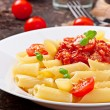 Penne pasta with bolognese sauce, parmesan cheese and basil — Stock Photo #40426289