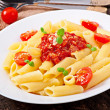 Penne pasta with bolognese sauce, parmesan cheese and basil — Stock Photo #40426291