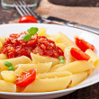 Penne pasta with bolognese sauce, parmesan cheese and basil — Stock Photo #40426293