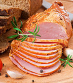 Ham, bread and spices on wooden board. — Stock Photo