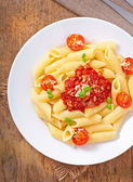 Penne pasta with bolognese sauce, parmesan cheese and basil — Stock Photo
