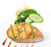 Fish dish - fried fish fillet with vegetables on white background — Stock Photo