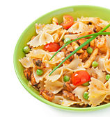 Farfalle pasta with seafood, cherry tomatoes and green peas — Stock Photo