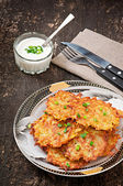 Fried potato pancakes on the old wooden background — Stock Photo