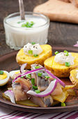 Herring salad with onions and baked potato — Stock Photo