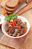 Roast chicken liver with vegetables — Stock Photo