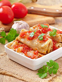 Stuffed cabbage with tomato sauce decorated with parsley — Stock Photo