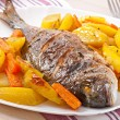 Dorada baked with potatoes — Stock Photo #42867587