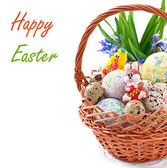 Colorful Easter eggs in a basket on a white background — Stock Photo
