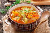 Vegetable soup on the old wooden background — Stockfoto