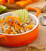 Oatmeal with pumpkin, apples, nuts and honey — Stock Photo