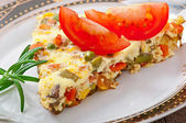 Omelette with vegetables — Stock Photo
