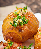Baked potato with cheese and butter — Stock Photo