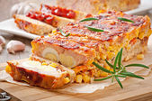 Homemade ground meatloaf with ketchup and rosemary — Stock Photo