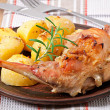 Oven Baked rabbit legs with potatoes and rosemary — Stock Photo