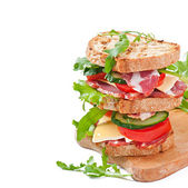 Sandwich with ham, cheese and fresh vegetables on white background — Stock Photo