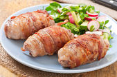 Grilled meat rolls wrapped in strips of bacon — Stockfoto