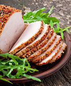 Baked pork  with arugula leaves — Stock Photo