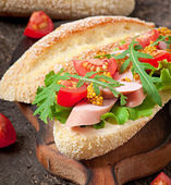 Sandwich on wooden board — Photo