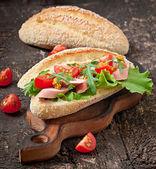Sandwich on wooden board — Stock Photo
