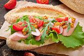 Sandwich on wooden board — Stockfoto