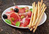 Grissini with ham — Stock Photo