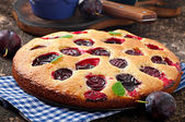 Cake with plums — Stock Photo