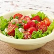 Tomato salad with lettuce, cheese and mustard and garlic dressing — Stock Photo #50812365