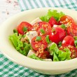 Tomato salad with lettuce, cheese and mustard and garlic dressing — Stock Photo #50812423