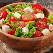 Tomato salad with lettuce, cheese and mustard and garlic dressing — Stock Photo #50812477