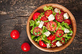 Tomato salad with lettuce, cheese and mustard and garlic dressing — Stock Photo
