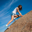 Stock Photo: Young girl climbs mountain