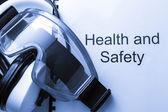 Hälsa och säkerhet register med glasögon och hörlurar — Stockfoto