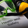Stock Photo: Health and safety register with goggles and earphones