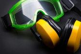 Green goggles with earphones on black — Stockfoto