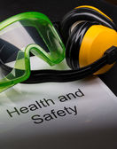 Health and safety register with goggles and earphones — Foto Stock