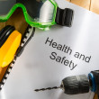 Health and safety Register with goggles, drill and earphones - Zdjęcie stockowe