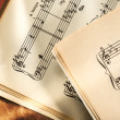 Music notes on paper background - Stock Photo